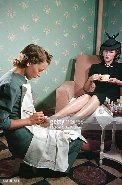 A view as a woman has a pedicure in a salon circa 1940 in New York New York