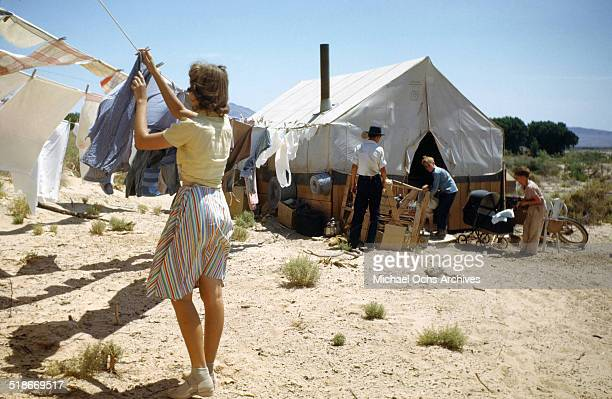 A view as a women hangs her clothes to dry at Tent City Nevada housing for workers and thier families at the Basic Magnesium Incorporated a Magnesium...