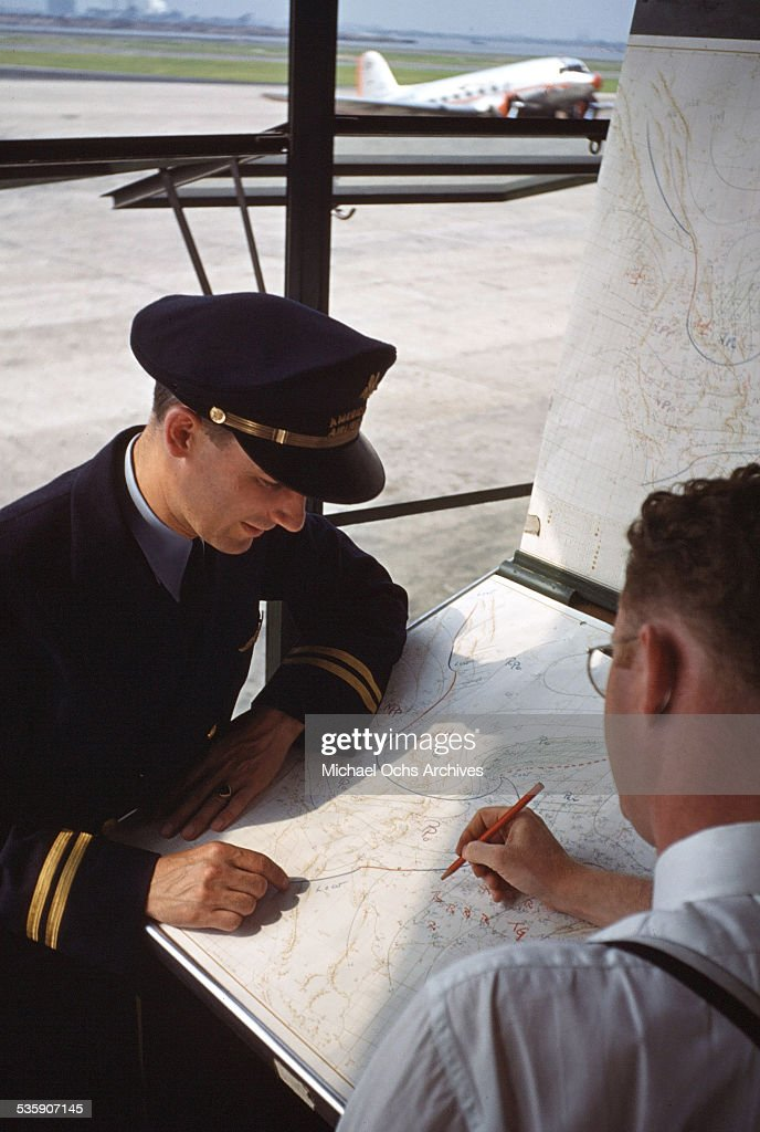 A view as an American Airlines pilot gets instructions.