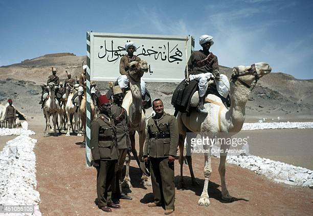 A view as an Egyptian Army soldiers ride camels in the desert of Aswan Egypt
