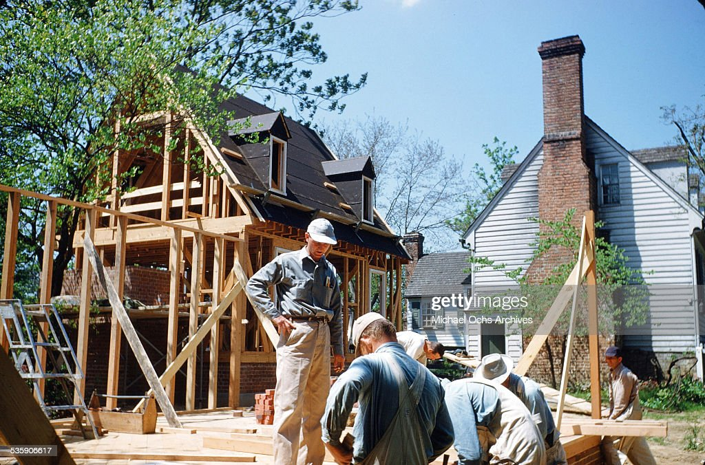 A view as construction workers work on reconstructing homes in Colonial Williamsburg, Virginia. A living history of life in circa 1700's.