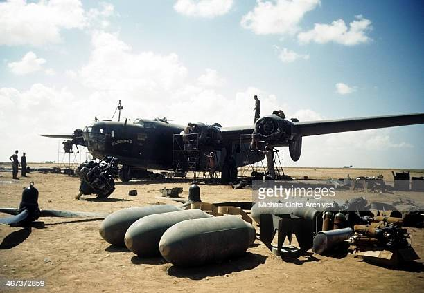 A view as crew members of the 44th Bombardment Group work on a B24 Liberator at the US Air Force Base in Benghazi Libya