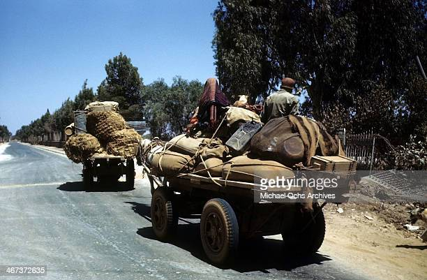 A view as locals load their possessions on a cart in Benghazi Libya