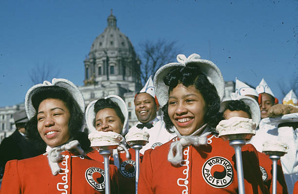 A view as Northern Pacific marching band parade down the street during the StPaul Winter Carnival in StPaulMinnesota