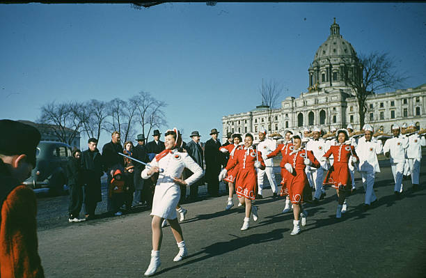 A view as Northern Pacific marching band parades down the street during the StPaul Winter Carnival in StPaulMinnesota