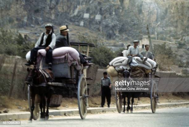 A view as Sicilians drive their wagons out of town after Allied forces won the campaign and the invasion of Sicily called Operation Husky during the...