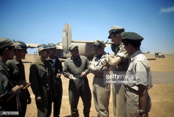A view as the 376th Bombardment Group talk with a B24Liberator in the background at the US Air Force Base in Benghazi Libya