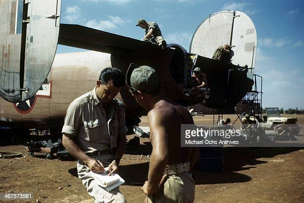 A view as the 389th Bombardment crew members work on a B24 Liberator at the US Air Force base in Benghazi Libya