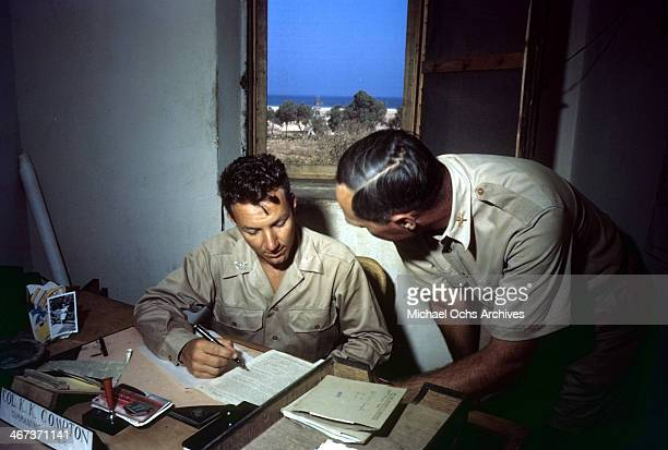 View as the Colonel K.K. Compton of the 376th Bombardment Group reviews papers at the U.S Air Force Base in Benghazi, Libya. K.K. Compton