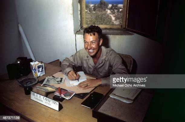 A view as the Colonel KK Compton of the 376th Bombardment Group smiles at his desk at the US Air Force Base in Benghazi Libya KK Compton