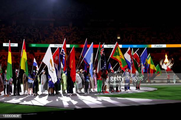 View as the flag bearers of the competing nations enter the stadium during the Closing Ceremony of the Tokyo 2020 Olympic Games at Olympic Stadium on...