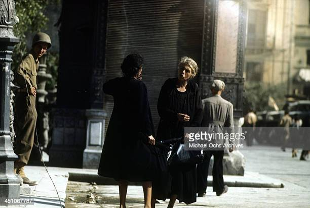 A view as two Sicilian women talk in the streets after Allied forces won the campaign to invade Sicily called Operation Husky during the World War II...
