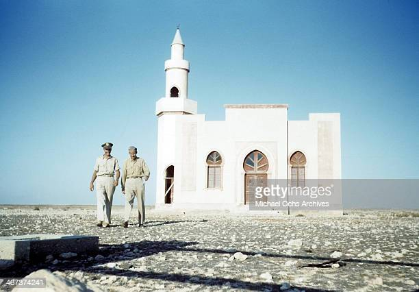 A view as two US Air Force officers from 98th Bomber Group walk past a mosque in Benghazi Libya