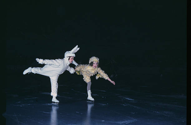 A view as two young kids perform on ice during the StPaul Winter Carnival in StPaulMinnesota