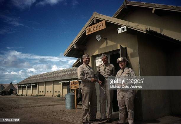 A view as US Air Force Officers standing at the Officers mess tent at the US Army and Air Force base in Natal Brazil