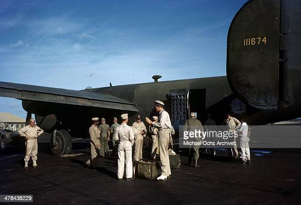A view as US servicemen load a C87 Liberator Express Transport plane at the Parnamirim airport at the US Army and Air Force base in Natal Brazil