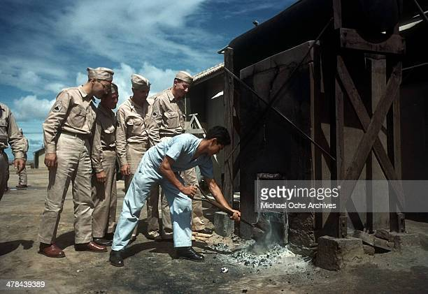 A view as US servicemen watch a Brazilian worker at the Parnamirim airport at the US Army and Air Force base in Natal Brazil