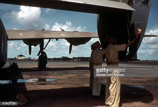 A view as US servicemen work on a C87 Liberator Express Transport plane at the Parnamirim airport at the US Army and Air Force base in Natal Brazil