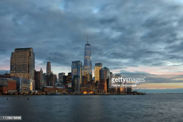 View at Downtown Manhattan with One World Trade Center at dusk