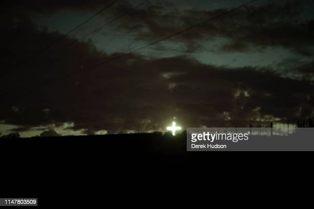View at dusk of a illuminated cross as seen from a road north of Durbanville Cape Town Western Cape South Africa April 30 2019