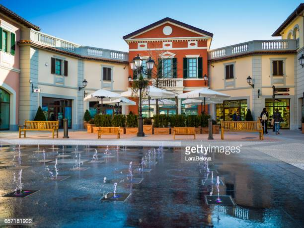 Serravalle Scrivia - March 17, 2017:  view at new part of Outlet in Serravalle Scrivia, people walking and looking shop windows