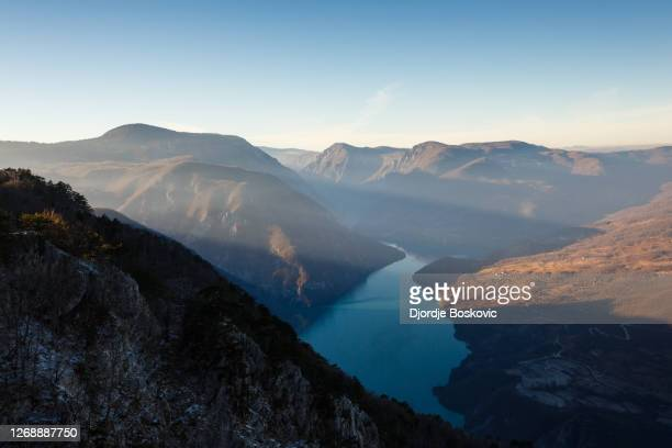 view at sunbeam over river drina from viewpoint banjska stena - serbia stock pictures, royalty-free photos & images