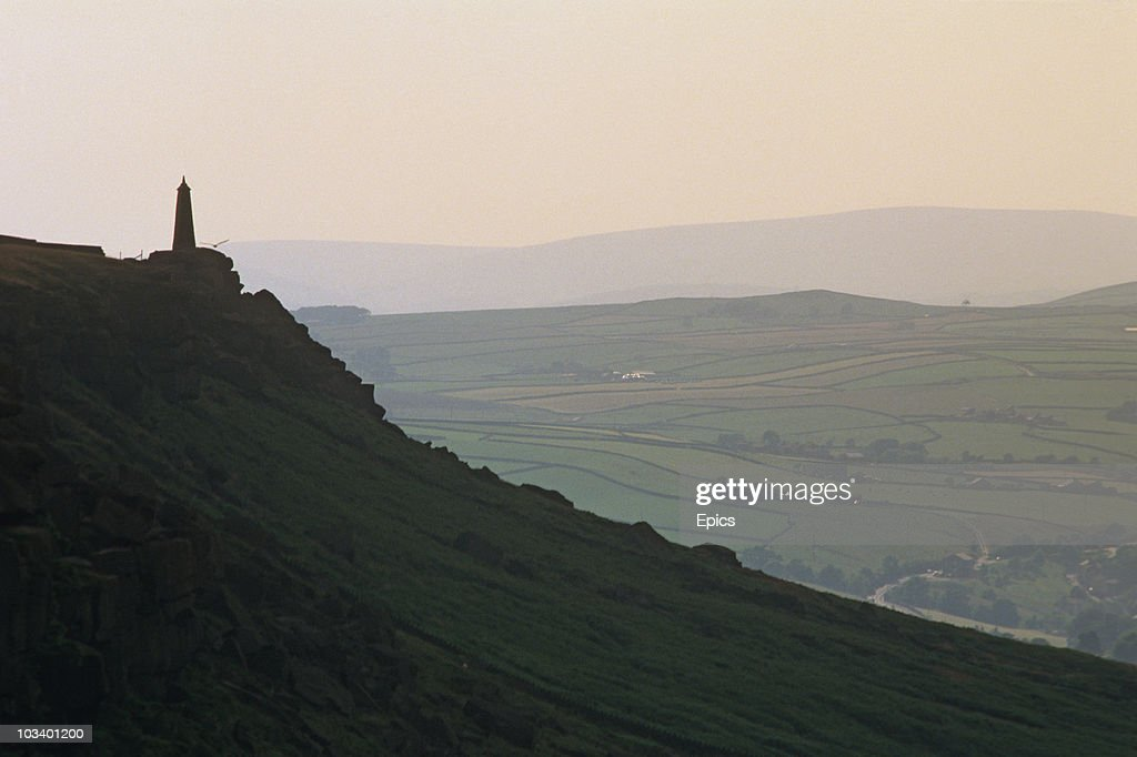 A view at sunset from Lund's Tower to Wainmans Pinnacle from Hebden Bridge, West Yorkshire, July 1997.