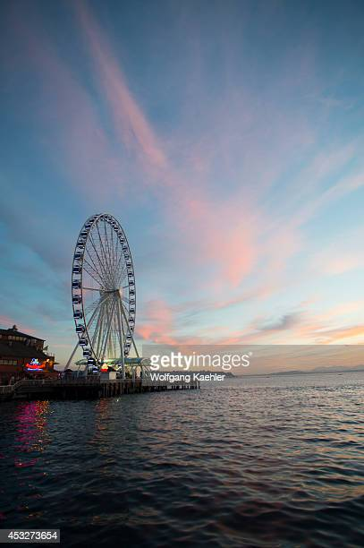 View at sunset from Seattle Waterfront Park of the Great Wheel at Seattle's Pier 57 Washington State USA