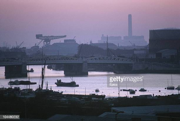 A view at sunset of the river Medway and surrounding industry Kent April 1970