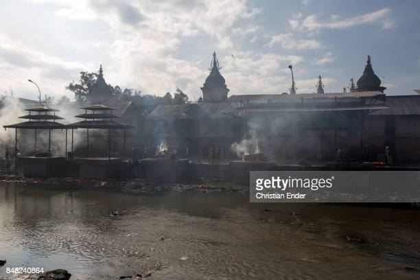 View at the Bagmati River with cremation spots and parts of the Pashupatinath temple in the background In Hindu tradition the dead are cremated on...