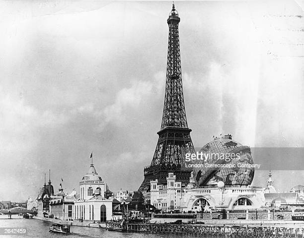 View at the 'Exposition Universelle' across the River Seine towards the Eiffel Tower and the 'Globe Celeste' The Eiffel Tower built to commemorate...