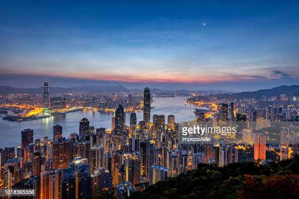 view at the peak observation point of hong kong city and building in the morning sunrise - victoria harbour hong kong stock pictures, royalty-free photos & images