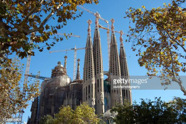 view at the sagrada familia church that is beeing restored at barcelona, spain - restoration style stock pictures, royalty-free photos & images