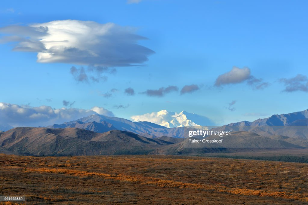 View at the snowcapped Mount Denali in autumn with dramatic clouds : Stock-Foto