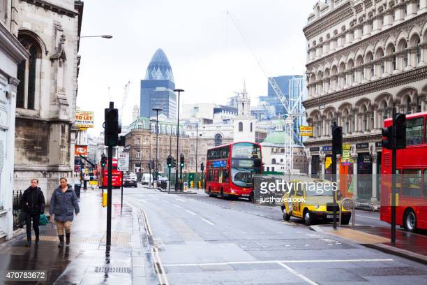 view back queen victoria street with buses and taxis - queen victoria stock pictures, royalty-free photos & images