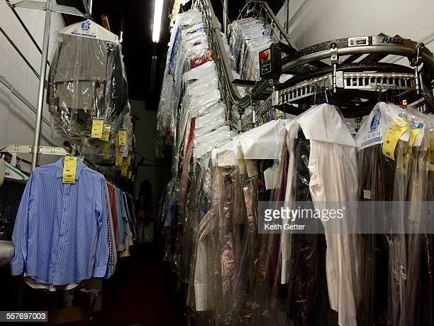 A view behind the counter of a neighborhood dry cleaning store which uses a regulated chemical solvent instead of water cleaned clothes are seen...