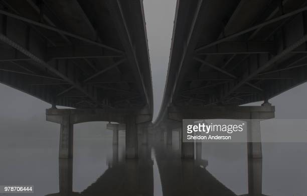view below bridge over lake, baton rouge, louisiana, usa - baton rouge stock pictures, royalty-free photos & images