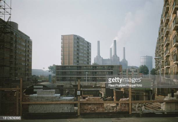 View between blocks of council flats in the Churchill Gardens housing estate in Pimlico of Battersea Power Station by the River Thames in London...