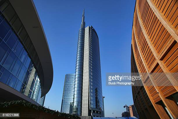 view between buildings of the unicredit tower in the porta nuova district of milan, italy - area designer label stock pictures, royalty-free photos & images