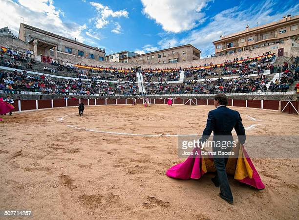 View Bocairent bullring , in a bullfight, bullfighter back with his cape and the steps of the crowded square. Bocairent, , Spain