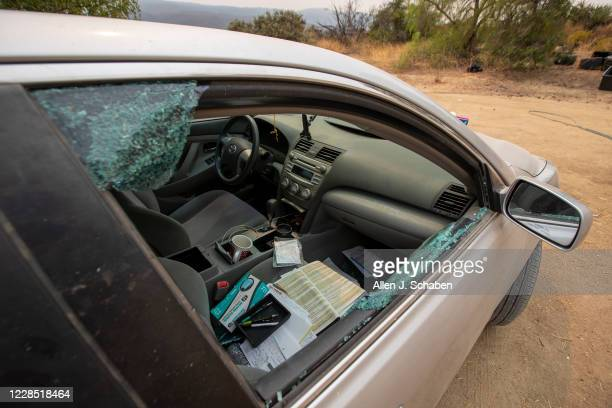 A view broken passenger window of a car doors at the property where seven people were shot to death over Labor Day weekend at an illegal marijuana...