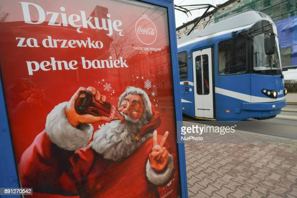 A view Christmas CocaCola add at a tram stop in Krakow's Old Town On Sunday 10 December 2017 in Krakow Poland