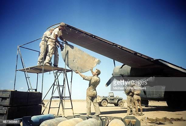A view crew members of the 376th Bombardment Group repair a B24Liberator at the US Air Force Base in Benghazi Libya