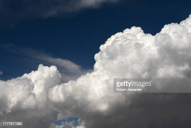 View cumulus clouds over Tennessee as seen from a passenger window on a United Airlines plane approaching Nashville, Tennessee.