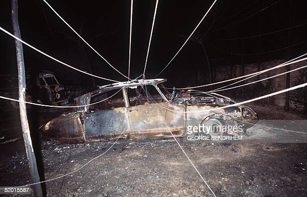 A view dated 12 July 1978 of a burnt out French car and tent of Los Alfaques campsite devastated at 03 pm 11 July 1978 by a propane gas explosion...