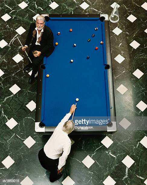 View Directly Above of Two Well-Dressed Senior Men Playing Pool