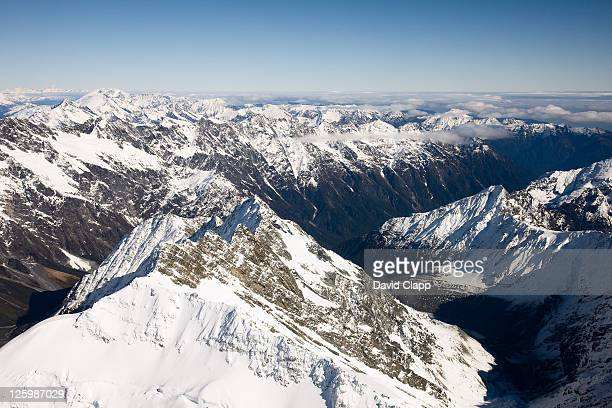View directly down Hooker Glacier, millions of tons of ice slowly cascade down from peaks of the Southern Alps and terminate within the sub-tropical rainforests of the South Island's West Coast, Mount Cook National Park, Southern Alps, South Island, New Ze