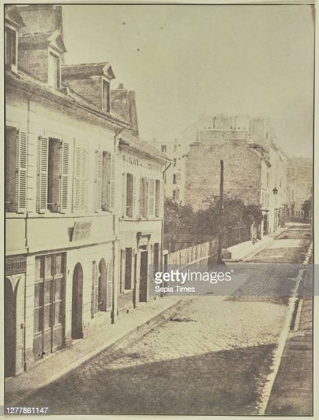 View Down a City Street; Attributed to Hippolyte Bayard , or Attributed to William Henry Fox Talbot ; about 1840–1849; Salted paper print; 23.2 ×...