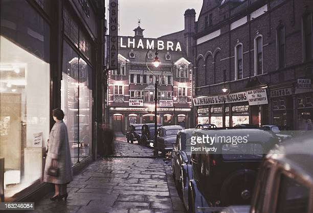 A view down a street towards the Alhambra Theatre in Lower North Street Belfast Northern Ireland June 1955 The theatre was destroyed by fire and...
