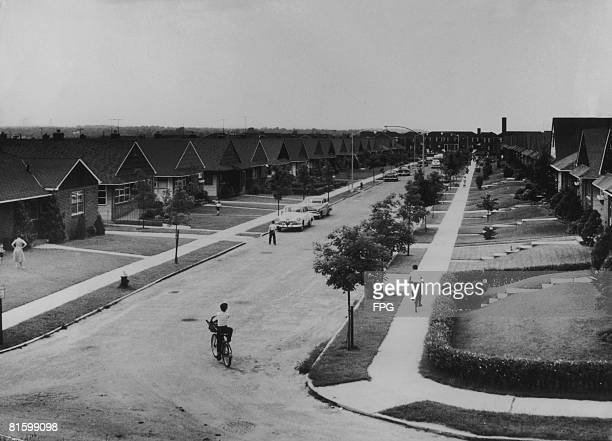 A view down a suburban street in the US circa 1950